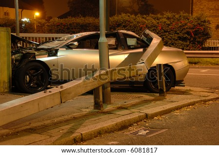 Car crashed under barrier at night, Editorial shot