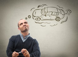 Car credit concept. Man dreaming about car