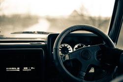 Car dashboard and steering wheel. Car interior.