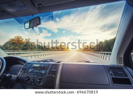 Car dashboard and steering wheel inside of car. Travel concepte #696670819