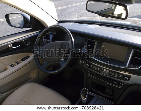 Car dashboard, steering wheel, control buttons, driver's seat #708528421