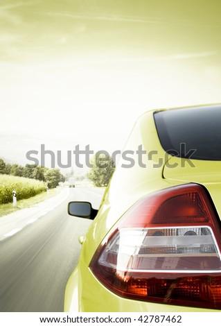 Car detail - back side, half. On the road.