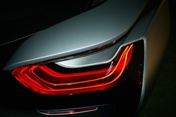 Car detail. New led taillight by night. The rear lights of the car, in hybrid sports car. Developed Car's rear brake light.