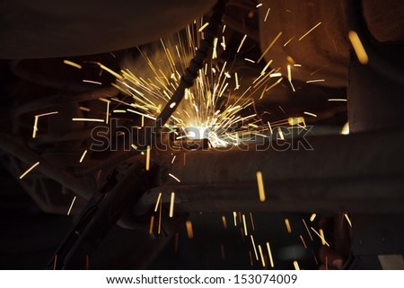 Car detail of welding , Welder at work