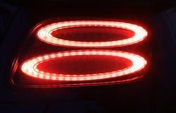 car detail, red car rear lights at night
