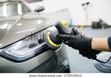 Shutterstock Car detailing - Hands with orbital polisher in auto repair shop. Selective focus.