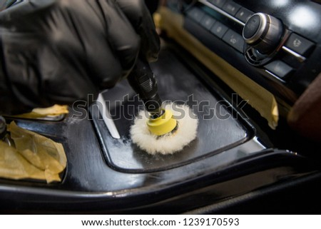 car detailing - polishing decorative details #1239170593