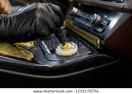 car detailing - polishing decorative details #1239170596