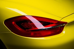Car detailing series: Clean taillight of yellow sports car