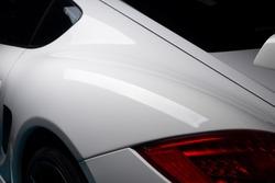 Car detailing series: Closeup of clean white sports car