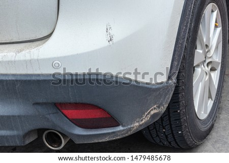 car : dirty car,Dirty Rear Car in dust after driving on a dirt road