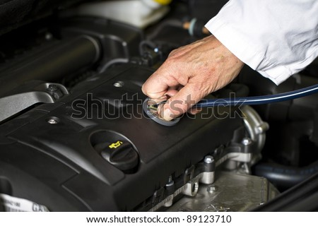 Car doctor hand at the car shop