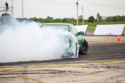 Car drifting, Car wheel spinning with smoke coming from wheels, Drag Racing on speed race track,