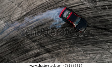 Car drifting, Drifting car on race track with smoke, Abstract texture and background black tire tracks skid on asphalt road, Wheel tire tracks background, Car tire track skid mark on race track.