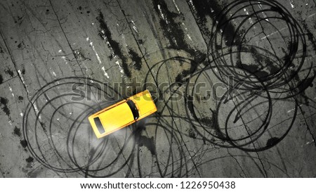 Car drifting. Professional driver drifts a yellow car on a parking lot. Aerial view from above.