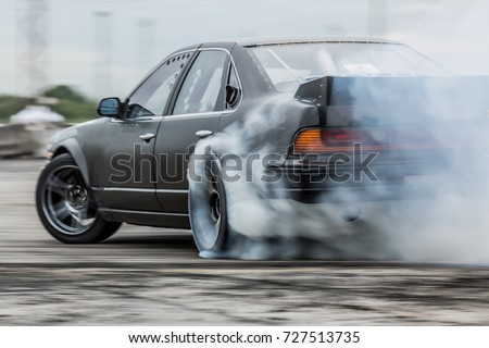 Car drifting, Sport car wheel drifting and smoking on track.