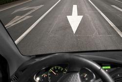 Car driving against traffic on asphalt road