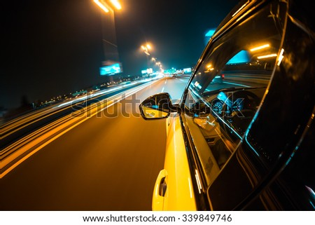 Car driving at night city with blur motion