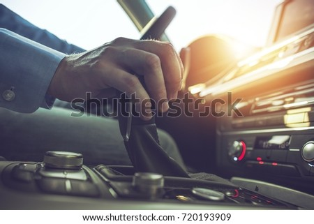Car Driving Concept. Driver Shifting To Drive Mode. Hand on Transmission Stick Closeup #720193909
