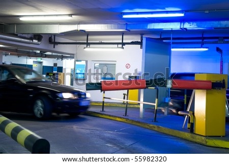car driving in a parking garage with blue light