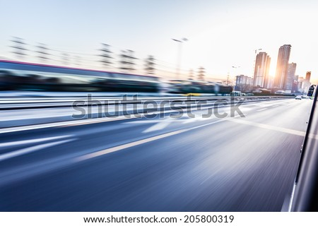 Car driving on freeway at sunset, motion blur #205800319