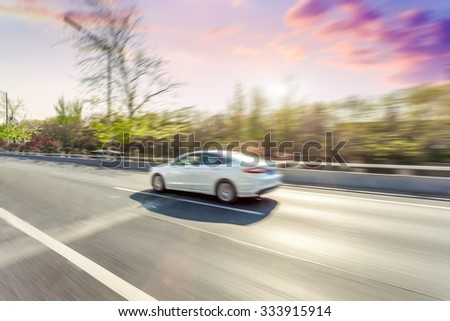 Car driving on road in Beijing, motion blur #333915914