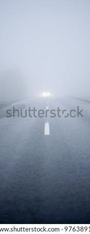 Car driving the Fog Road