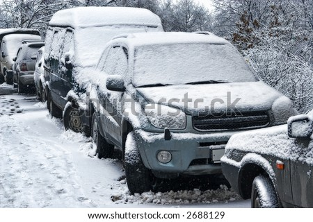 Car during a snowfall in town-snowdrift in city creates greater problems for automobile movement
