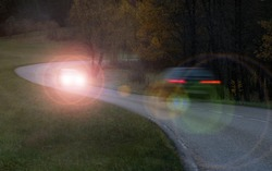 Car endangers oncoming traffic due to high beam light or incorrectly adjusted headlights