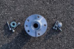 Car engine parts. Auto motor mechanic spare or automotive piece on dark road asphalt background. Black bituminous textured waterproofing. Automobile engine service