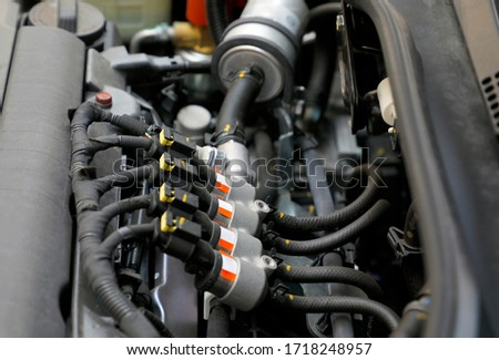 Car engine sequential gas injection. lpg car injectors in car engine need to service, gas injector installed in gasoline engine to use cheaper alternative fuel.