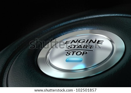 Car engine start and stop button with blue light, black textured background, close up and details on the text