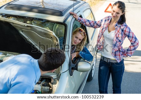 Car failure man help two female friends repair motor