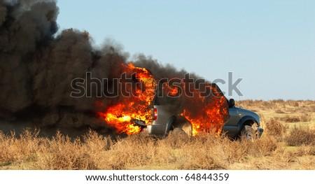 Car fire on desert rural road