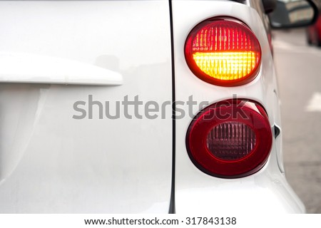 Car. Flashing turn signal indicating the right direction.