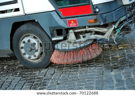 car for cleaning and dust sweeping to stone bridge barcelona