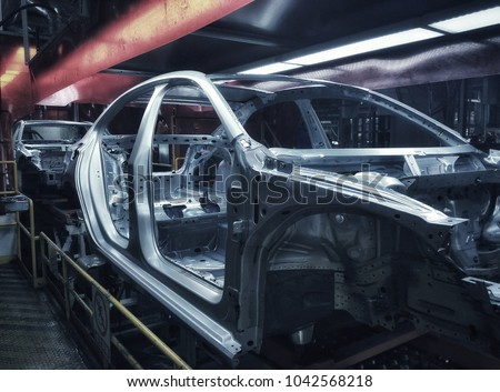 Car frame structure on automobile manufacturing and transportation line Foto stock ©