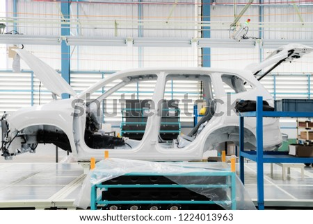 Car frame with unfinished assembly in the production line of  the automobile enterprise