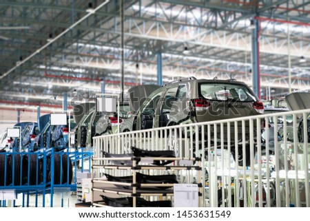 Car frame with unfinished assembly in the production line of  the automobile enterprise in smart factory 4.0.