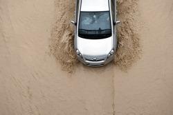 Car going through flood highway