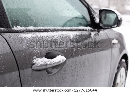 car handle in snow gray winter ice white frost frost frost #1277615044