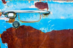 car handle with abstract corroded colorful wallpaper, Rust corroded oxidize colorful surface metal sheet plate pattern background.
