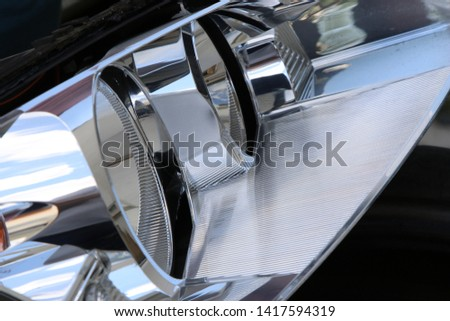 Car headlight, close up. Optical elements in the automotive headlights. #1417594319