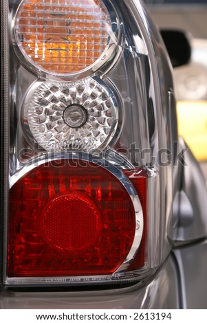 Car headlight close-up. Turn, stop and reverse signals.
