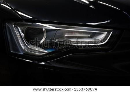 Car headlight. Exterior detail. #1353769094