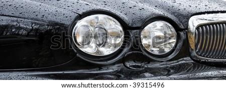 Car Headlight in rain drops (Jaguar Auto)