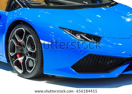 Car headlight of blue automobile closeup isolated on white background. #656184415