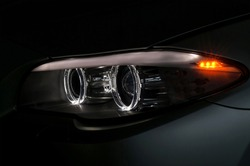 Car headlight with backlight. Exterior detail.