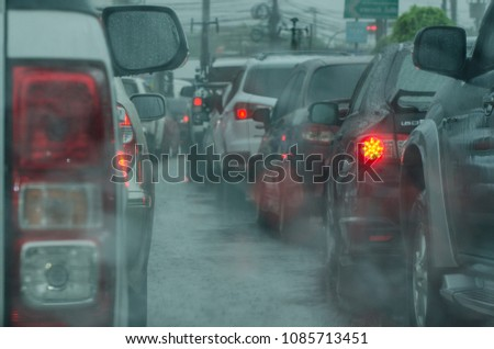 Car headlights, car rear lights while in the rain, and traffic on the road. #1085713451