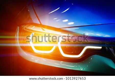 Car headlights. Exterior detail. Car luxury concept